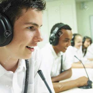 Students with headphones in the computer lab